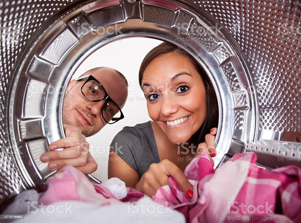 Young couple doing laundry - Royalty-free 2015 Stock Photo