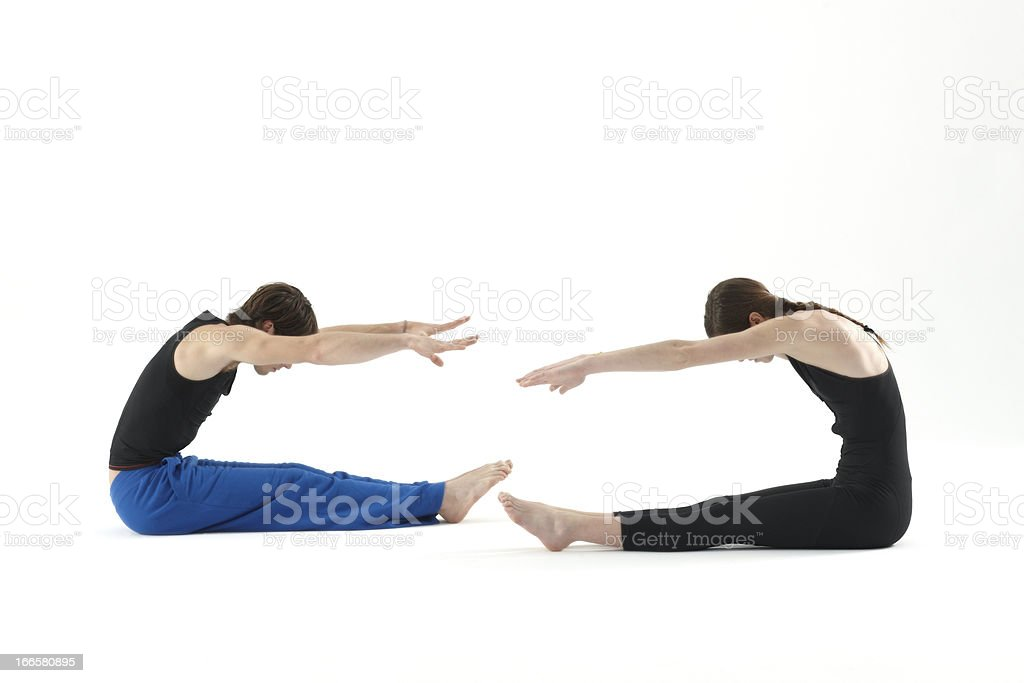 Young couple doing pilates exercises royalty-free stock photo