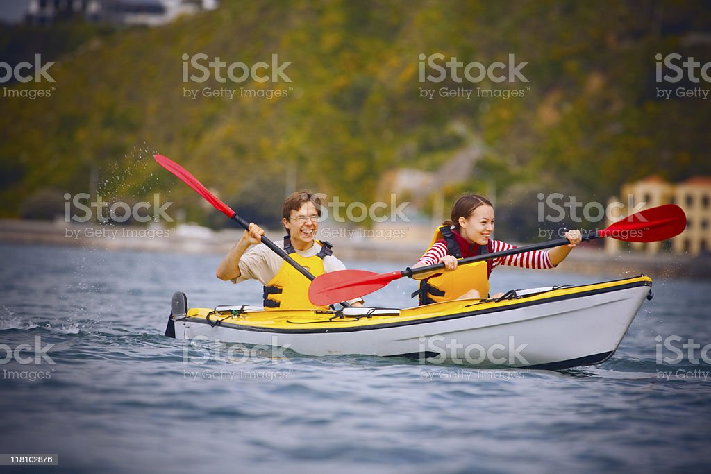 Young couple doing sea kayaking royalty-free stock photo