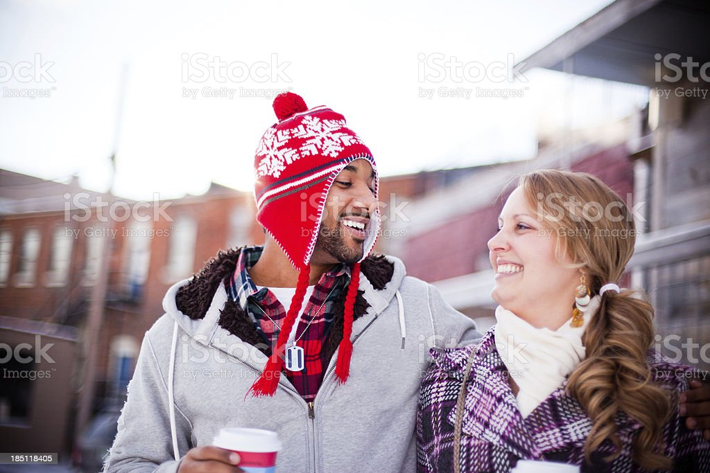 Young couple Downtown Sharing Coffee and Laughing royalty-free stock photo