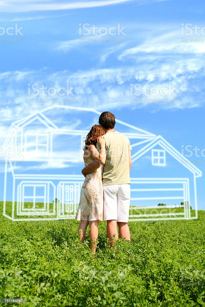 Young couple dreaming about a house stock photo