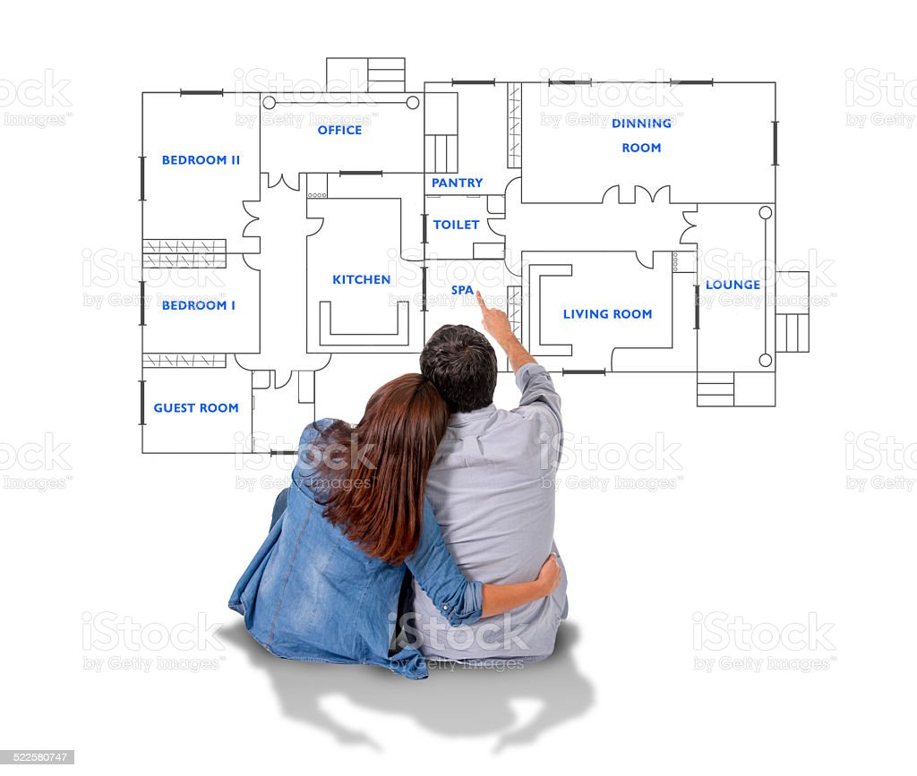 Young couple dreaming of  new house in real state concept stock photo