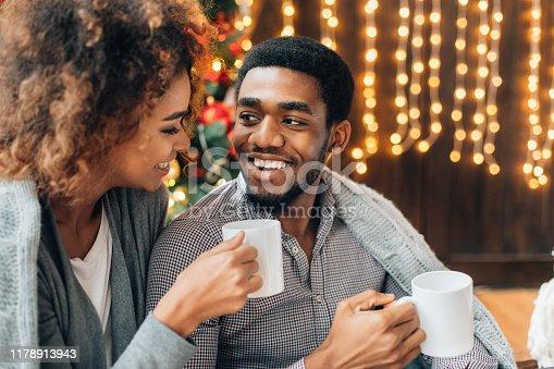 Portrait of happy black millennial man and woman enjoying coffee together