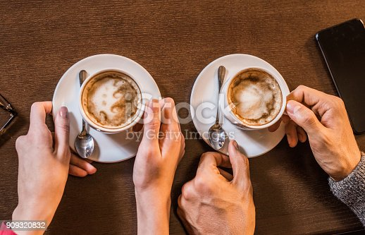 Young couple drinking coffee together.