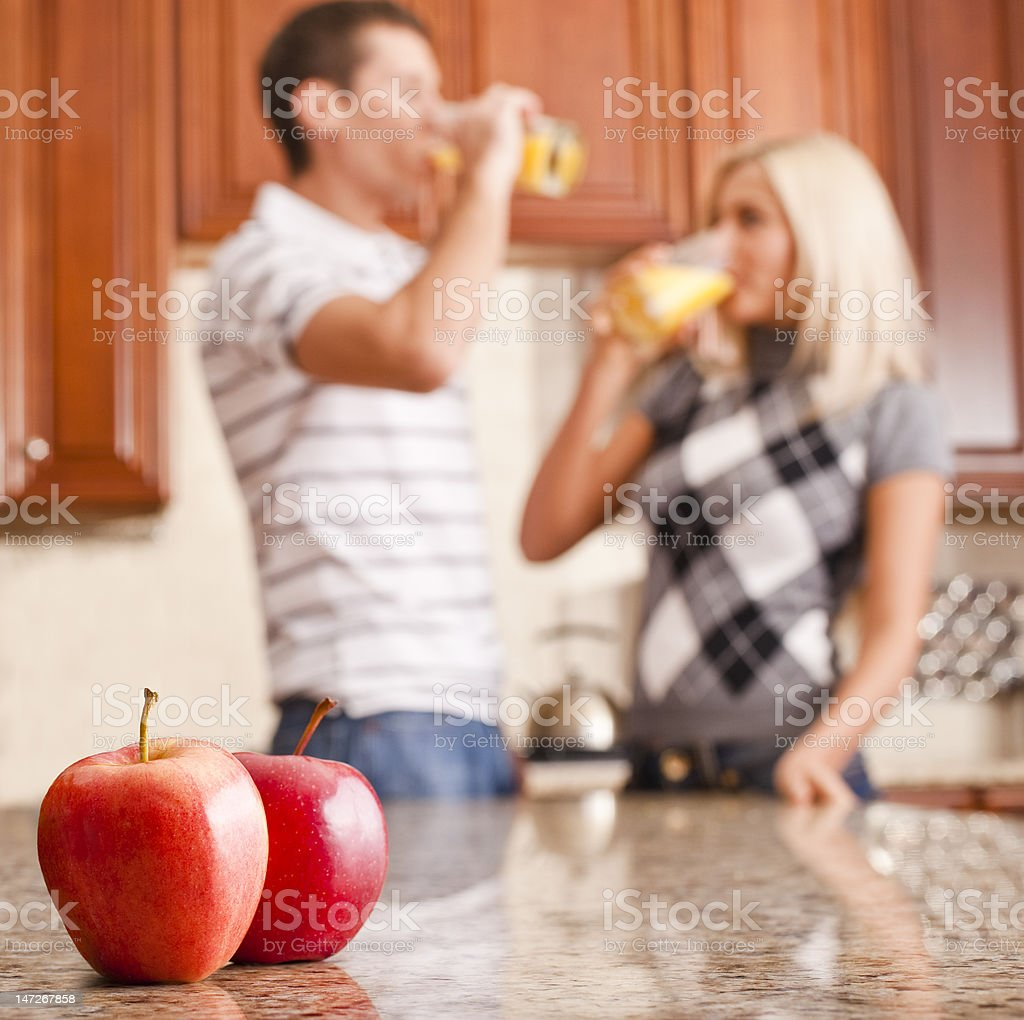Young Couple Drinking Glass of Orange Juice royalty-free stock photo