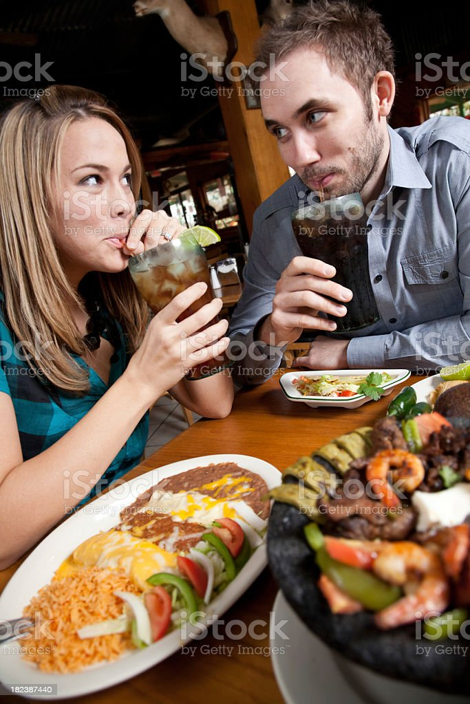 Young Couple Drinking Sodas With Mexican Food at Nice Restaurant stock photo