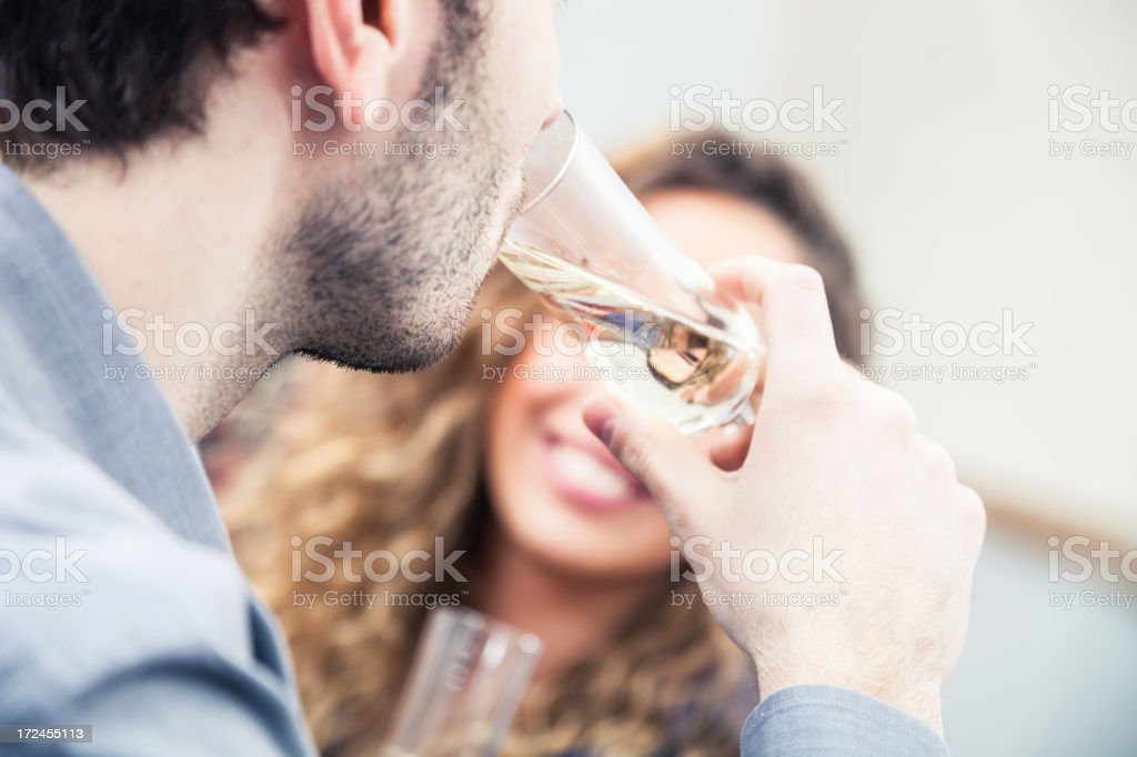 Young couple drinking together stock photo