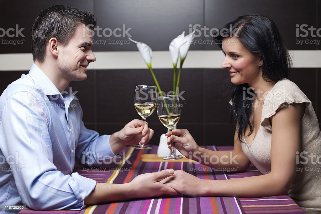 Young couple drinking wine and flirting royalty-free stock photo