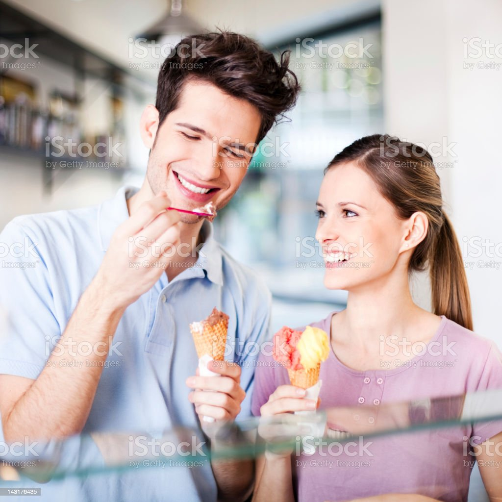 Young couple eating an ice cream stock photo
