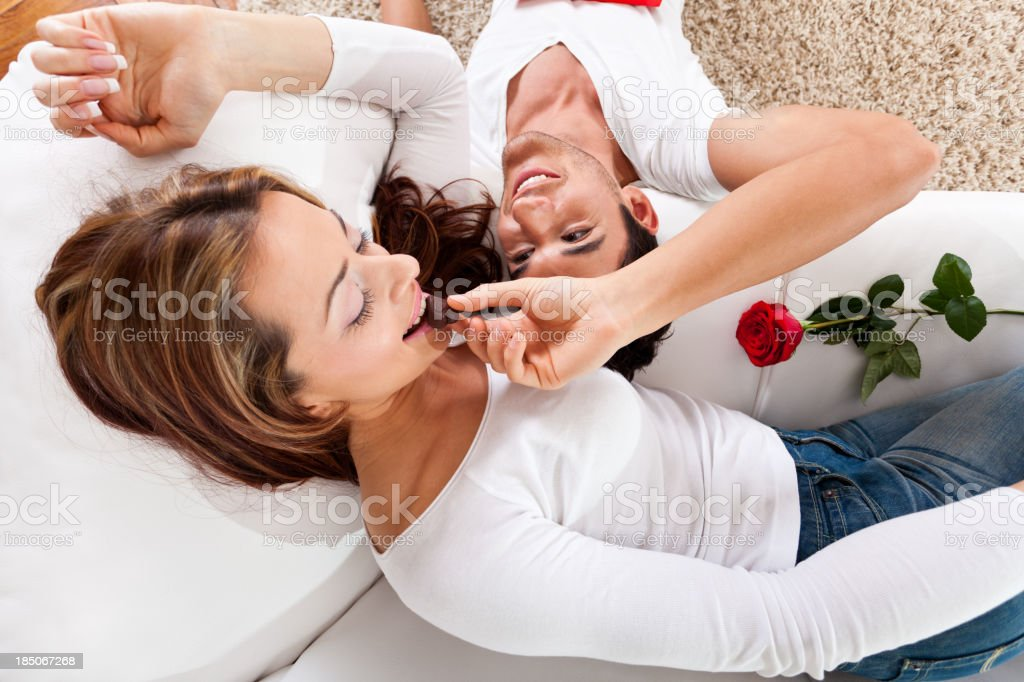 Young couple eating chocolate candies royalty-free stock photo