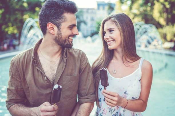 Young couple eating ice-creams stock photo