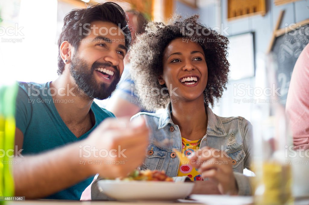 Young Couple Eating in a Bar stock photo