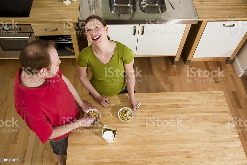 Young couple eating Takeout Noodles royalty-free stock photo