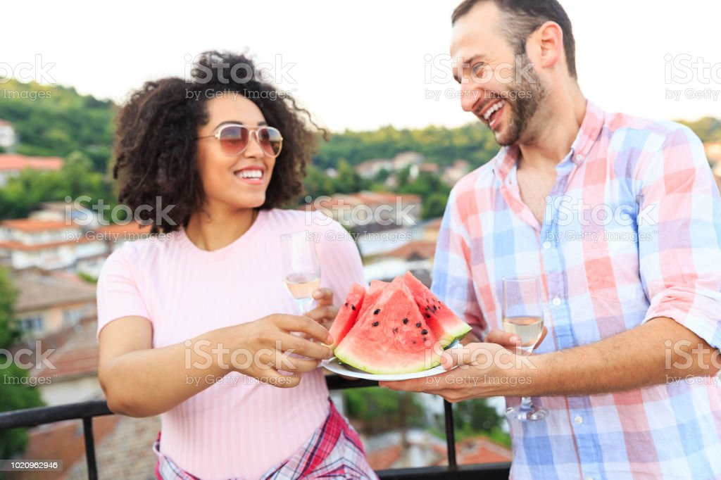 Young couple eating watermelon stock photo