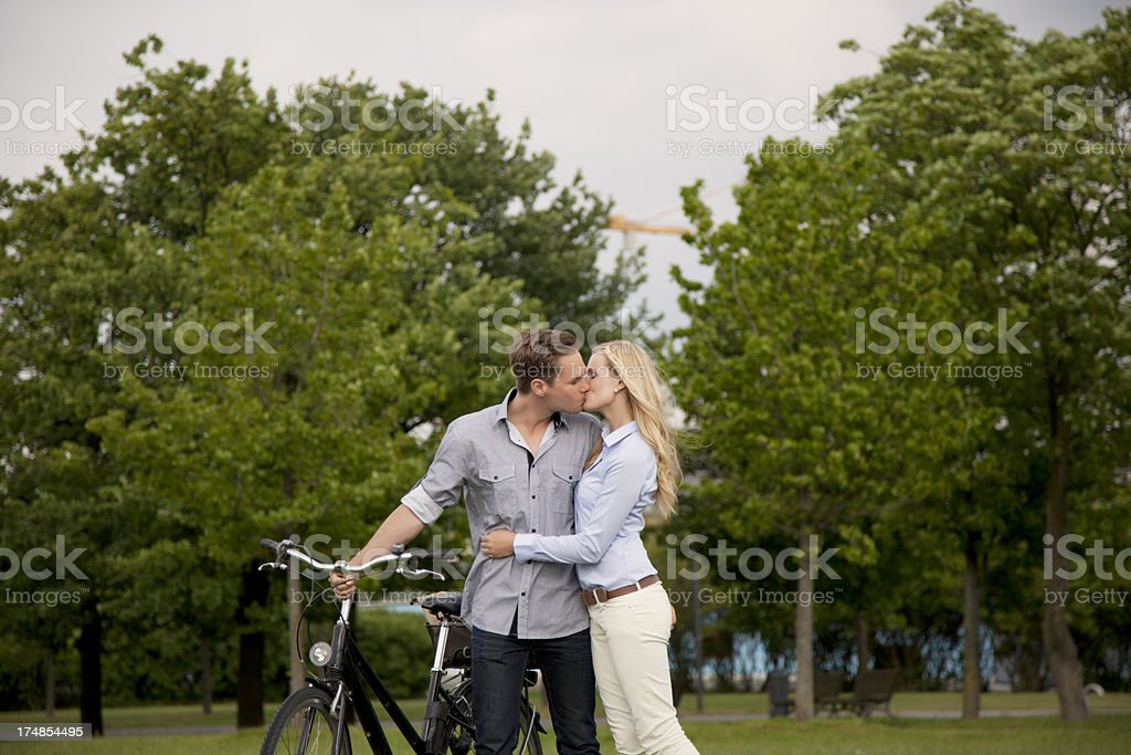 Young couple embracing and kissing royalty-free stock photo