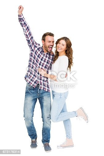673176670 istock photo Young couple embracing and posing 673176314