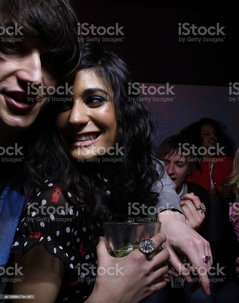 Young couple embracing at party in night club royalty-free stock photo