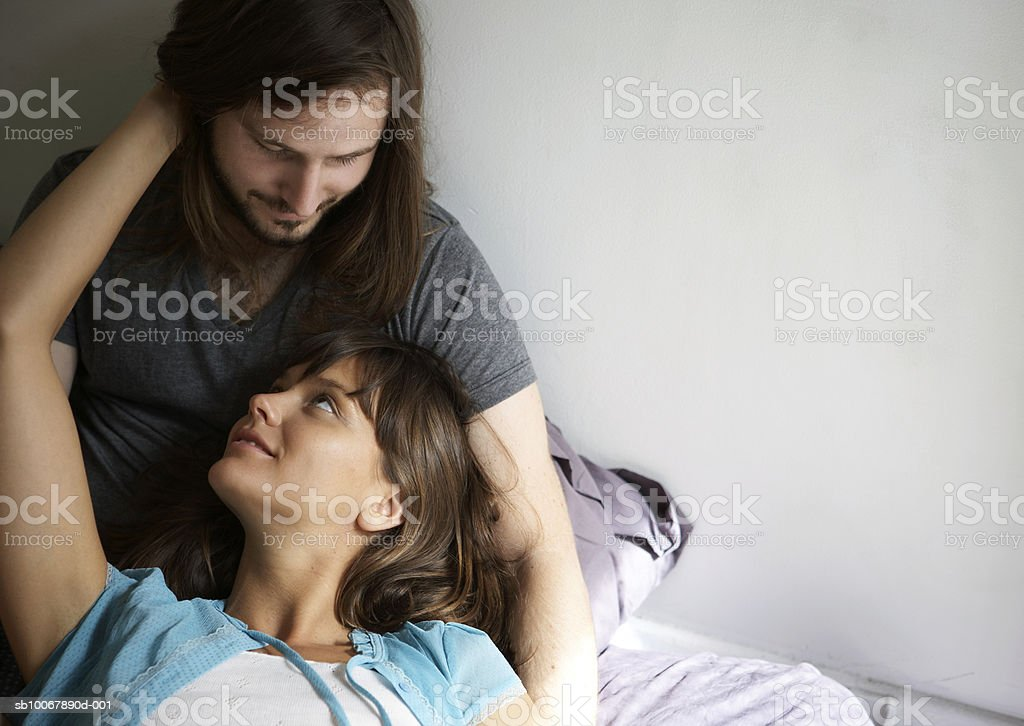 Young couple embracing, face to face, smiling 免版稅 stock photo