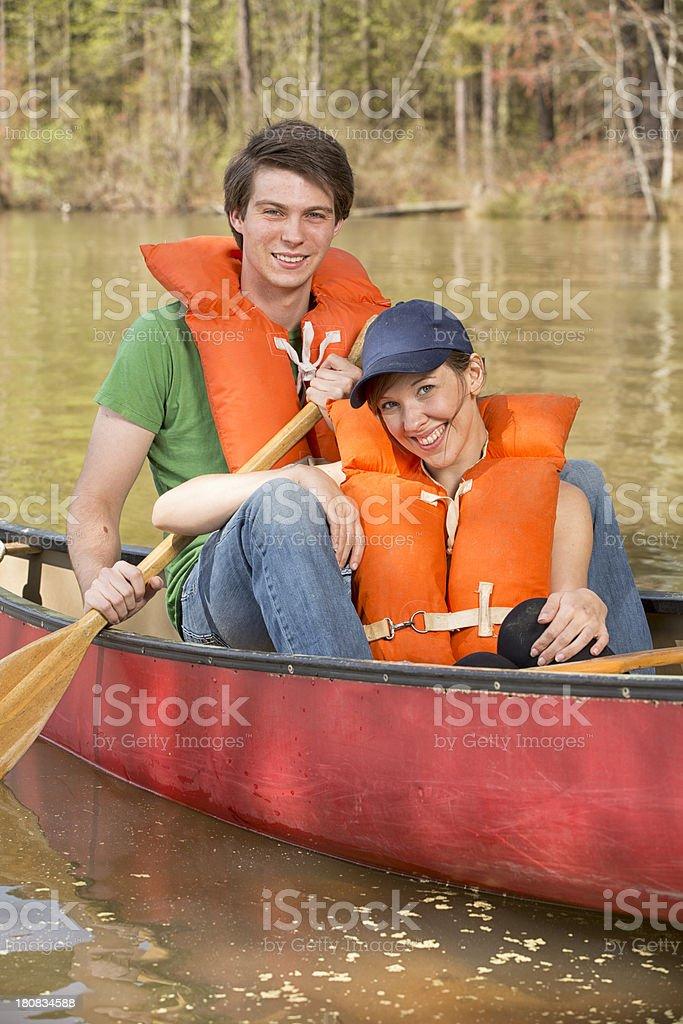 Young Couple enjoy a canoe ride royalty-free stock photo