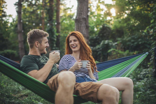 Young couple enjoy in hammock stock photo