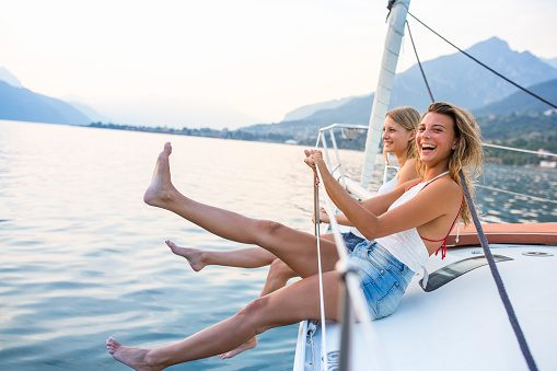 Young couple enjoy sailing on the sailboat