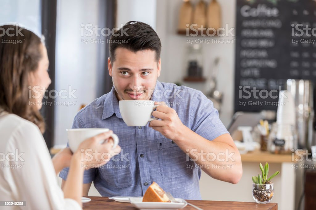 Young couple enjoy time together in coffee shop stock photo