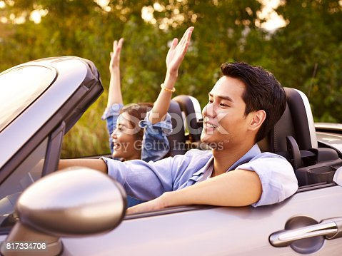 817334706 istock photo young couple enjoying a car ride 817334706