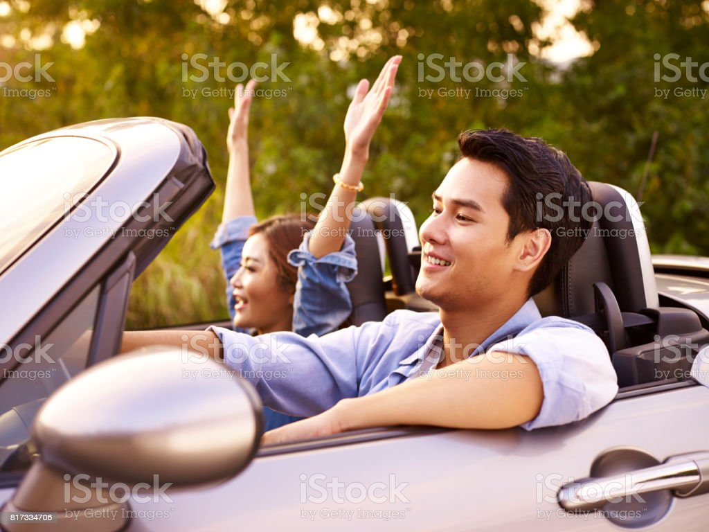 young couple enjoying a car ride stock photo