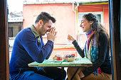 istock Young couple enjoying a laugh over tea on balcony 534085871