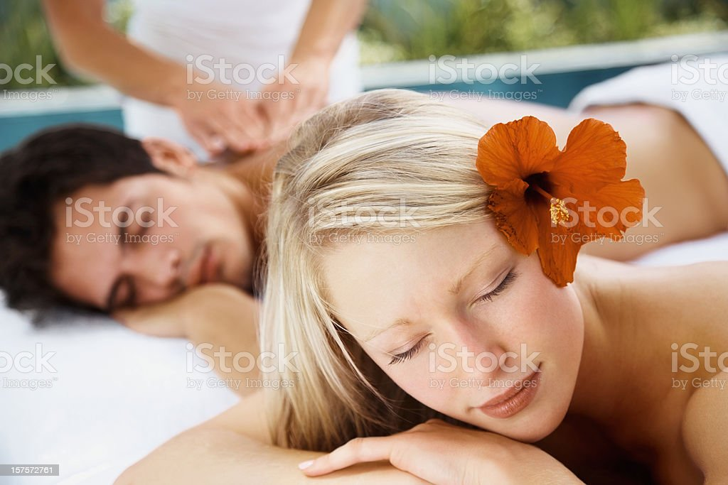 Young couple enjoying a peaceful body massage at spa royalty-free stock photo