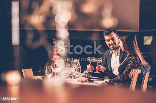 istock Young Couple Enjoying a Romantic Dinner Together 636349974