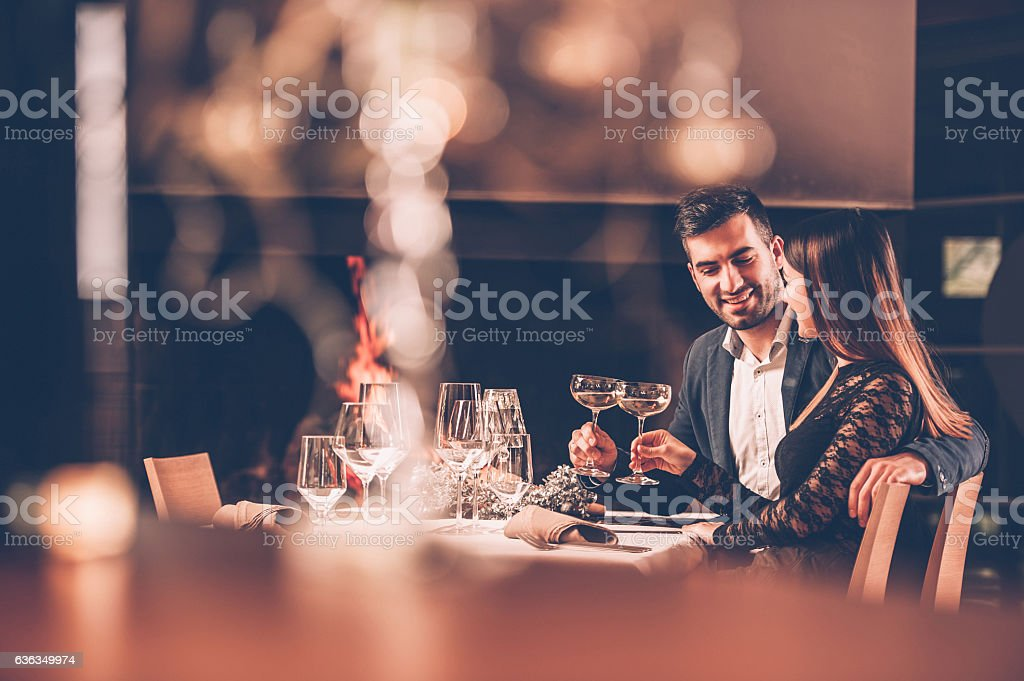 Young Couple Enjoying a Romantic Dinner Together stock photo