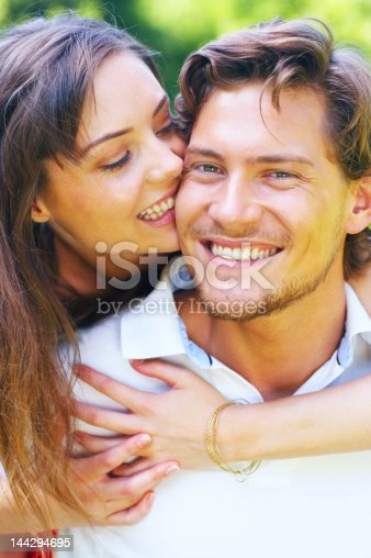 135359671 istock photo Young couple enjoying a summer's day 144294695