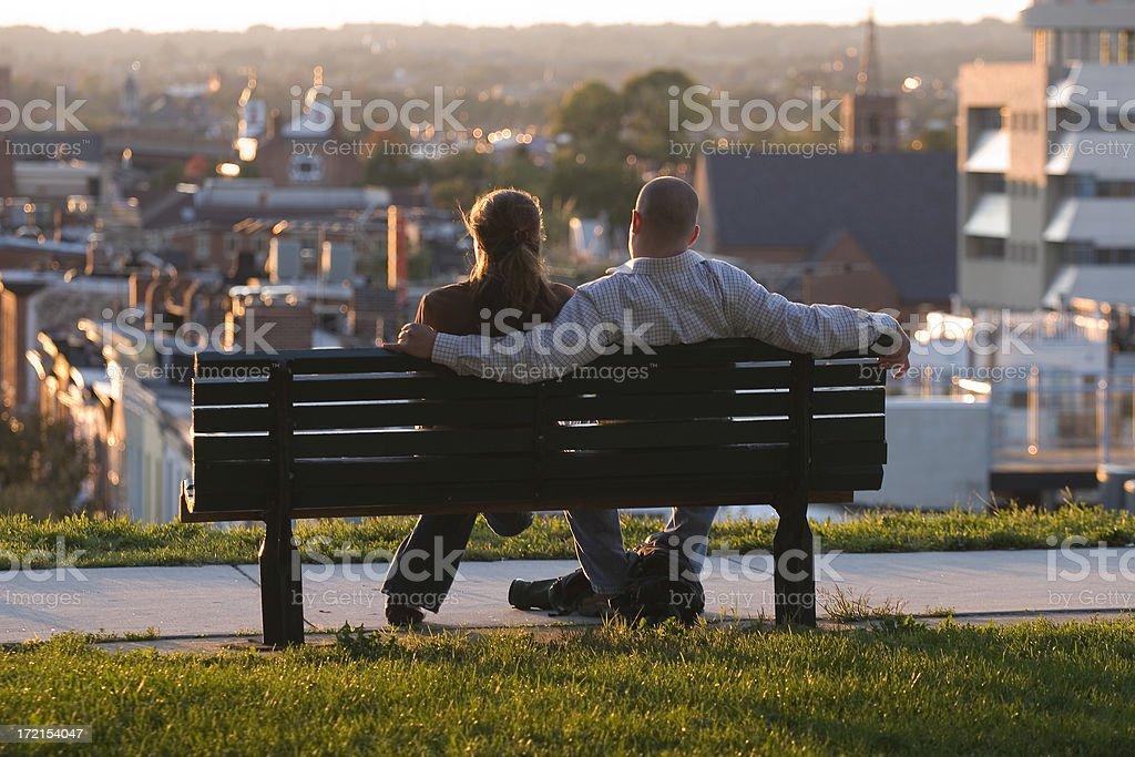 Young Couple Enjoying a Sunset royalty-free stock photo