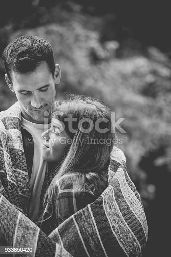 1083155024 istock photo Young couple enjoying camping in the forest 933850420