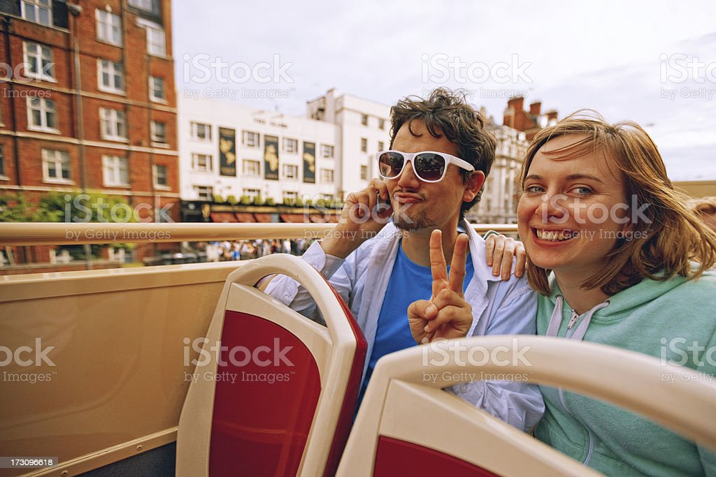 Young Couple Enjoying Double-Decker Bus ride in London stock photo