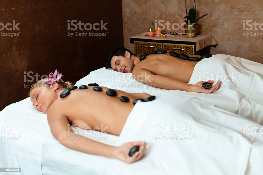 Young couple enjoying lastone therapy royalty-free stock photo