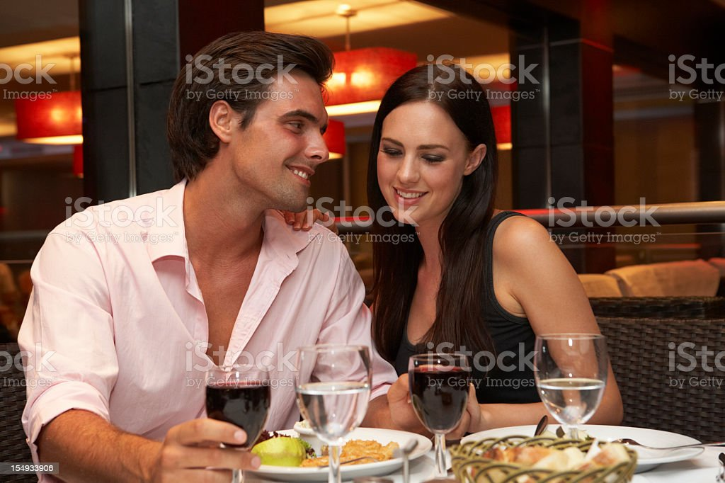 Young Couple Enjoying Meal In Restaurant royalty-free stock photo