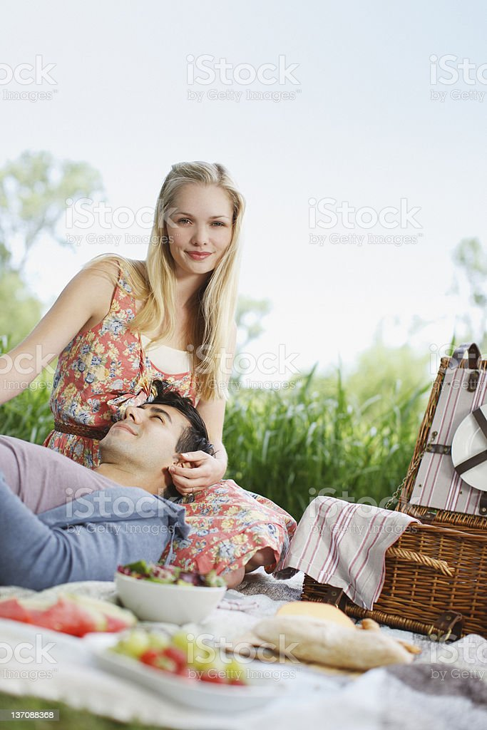 Young couple enjoying picnic in park royalty-free stock photo