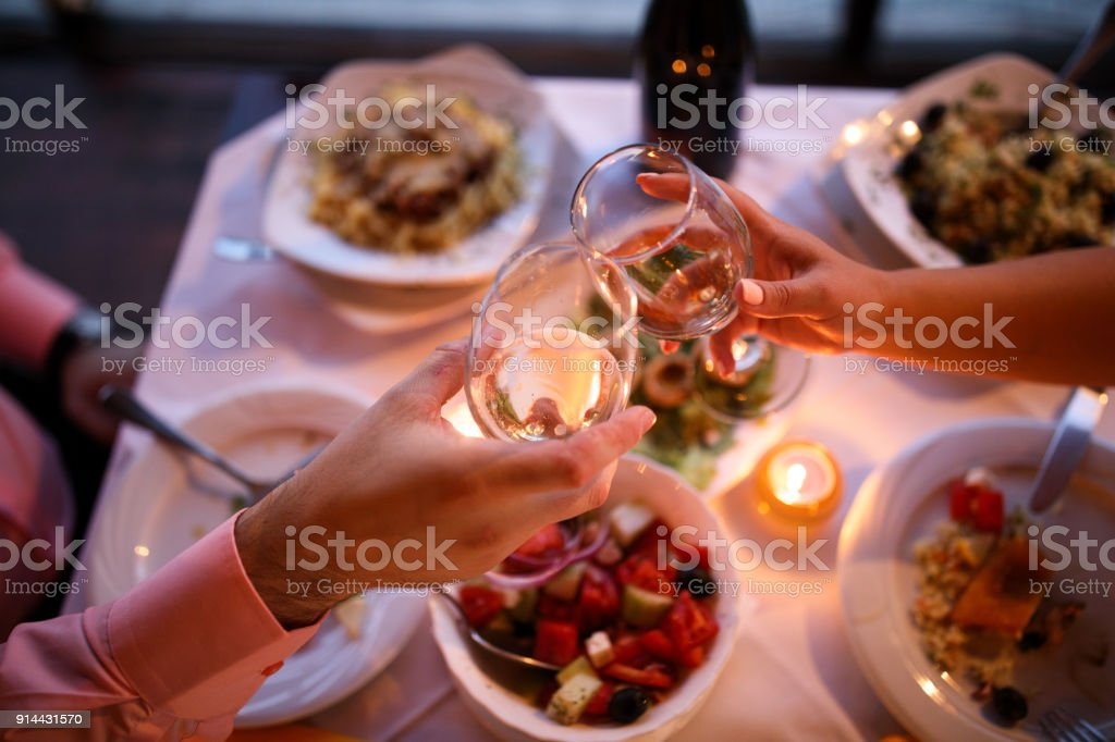 Young couple enjoying romantic dinner stock photo