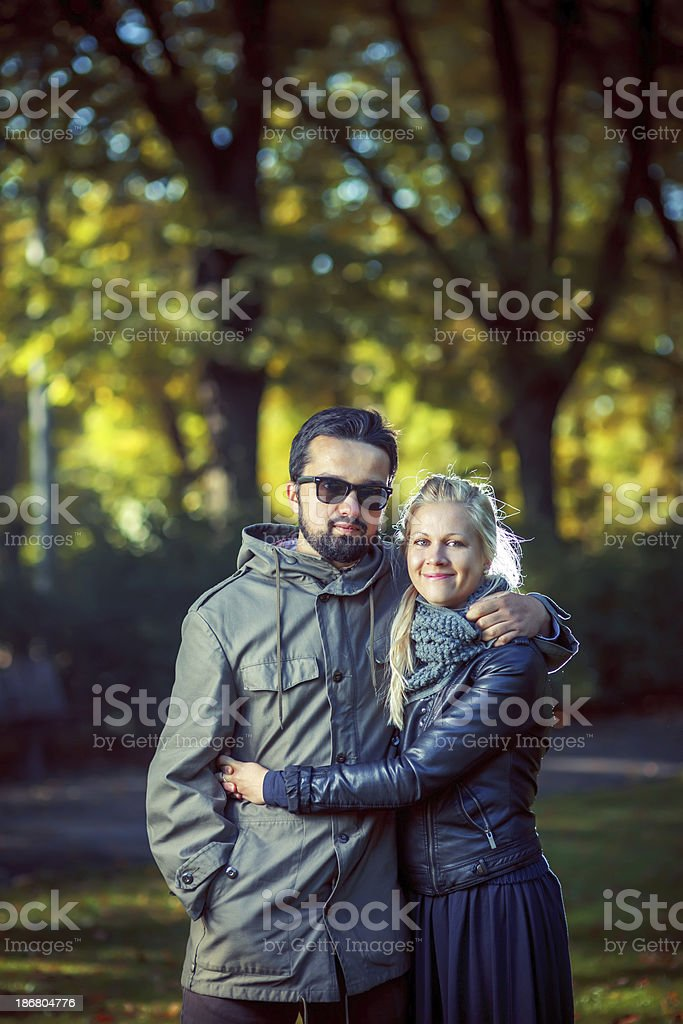 Young couple enjoying sunny Autumn day royalty-free stock photo