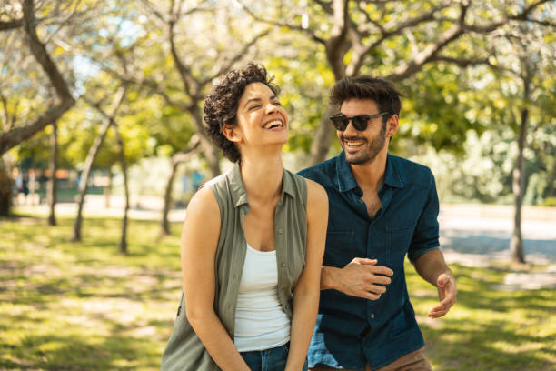 Young couple enjoying the sunny day at park Friendship, Couple - Relationship, Smiling, Public Park, Positive Emotion happy couple stock pictures, royalty-free photos & images