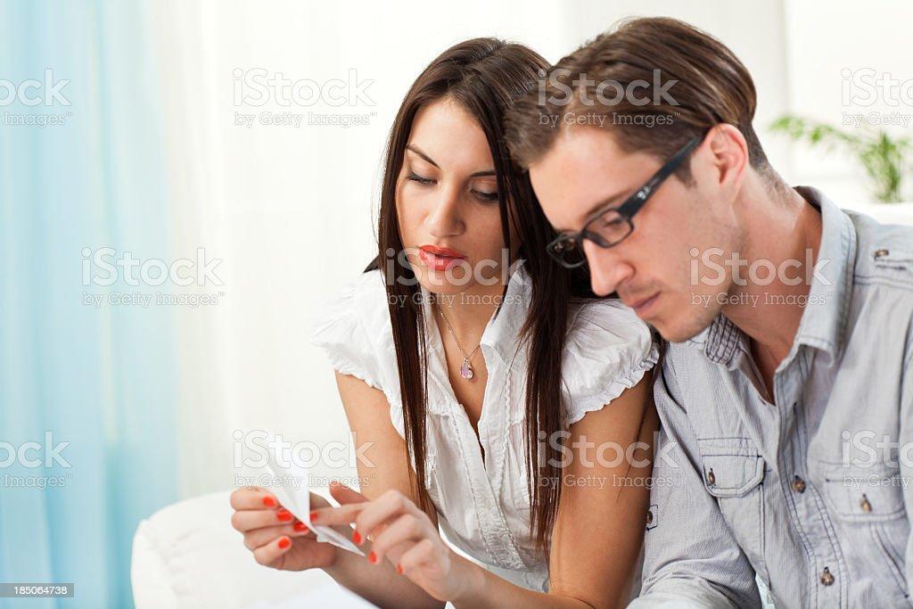 Young couple examing bills royalty-free stock photo