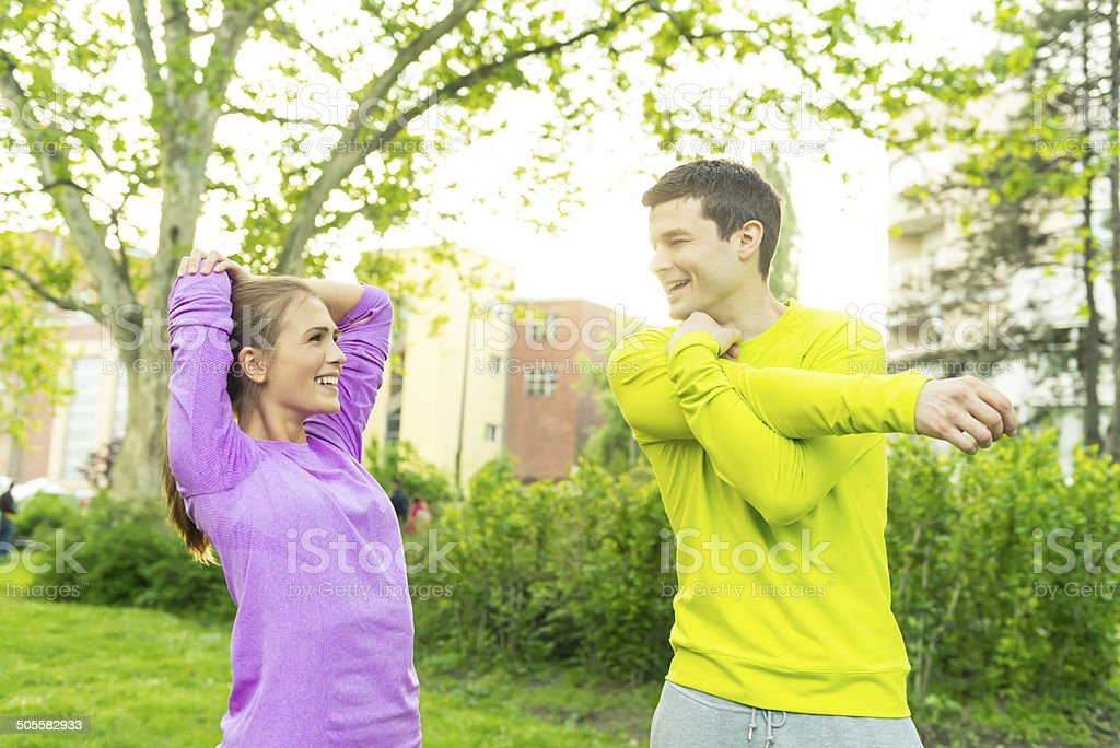 Young Couple Exercising In Park royalty-free stock photo