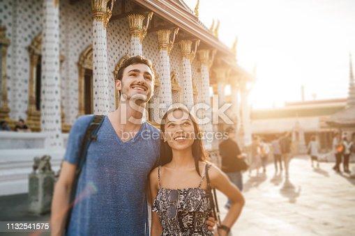 istock Young couple exploring a temple in Bangkok 1132541575