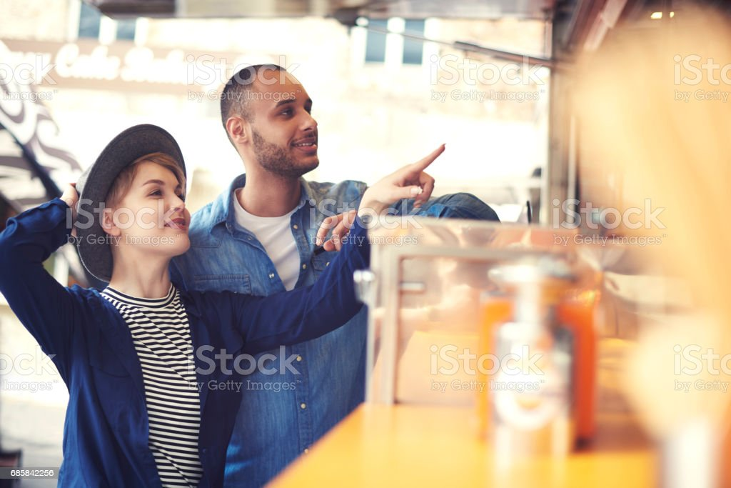 Young couple exploring new flavours stock photo