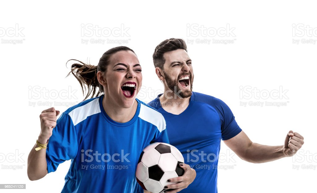 Young couple fan in blue uniform celebrating royalty-free stock photo