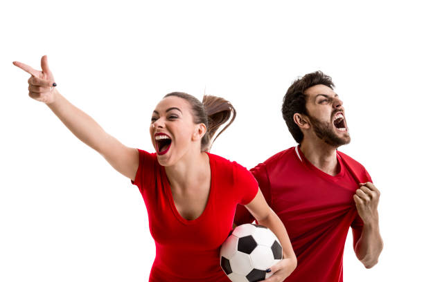 Young couple fan in red uniform celebrating stock photo