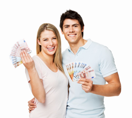 Young couple stand together while showing fanned money. Square shot. Isolated on white.