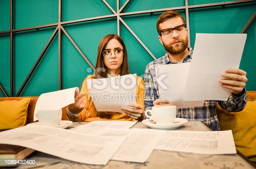 istock Young couple feel angry and get divorced try to make a deal 1089432400